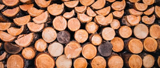 a pile of round logs for stock photography