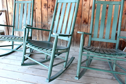 wooden chairs on a porch sells as stock photography