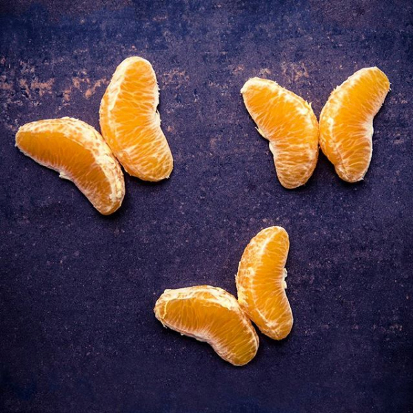 Creative stock photo showing oranges arranged as butterflies