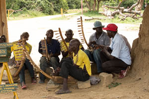 men singing and playing instruments BY JACKSON