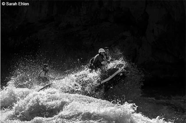 black and white photography of whitewater rafting