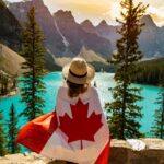 woman-draped-in-a-flag-of-canada-01 640px lr STOCK-min