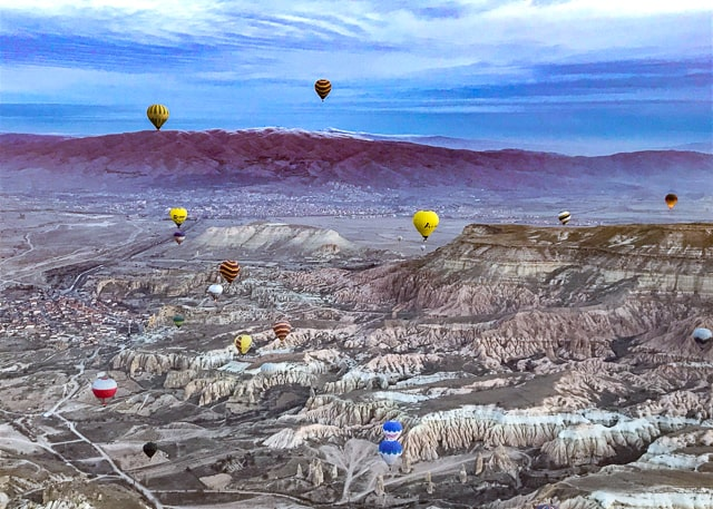 Hot air balloons drifting over Goreme Turkey