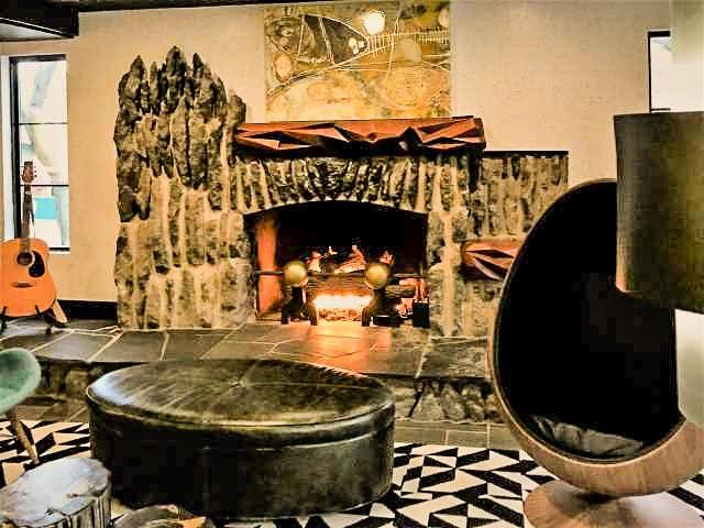 Lobby fireplace - Hotel Earl - Charlevoix, MI