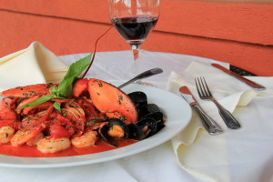 Out door restaurant with meal of Seafood Fradiavolo