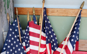 http://www.dreamstime.com/royalty-free-stock-photography-american-flags-against-corner-wall-home-red-white-blue-much-loved-gathered-together-standing-outside-image31163327
